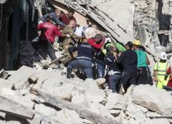 A man injured is carried by rescuers in Amatrice, central Italy, where a 6.1 earthquake struck just after 3:30 a.m., Italy, 24 August 2016. The quake was felt across a broad section of central Italy, including the capital Rome where people in homes in the historic center felt a long swaying followed by aftershocks. ANSA/ MASSIMO PERCOSSI